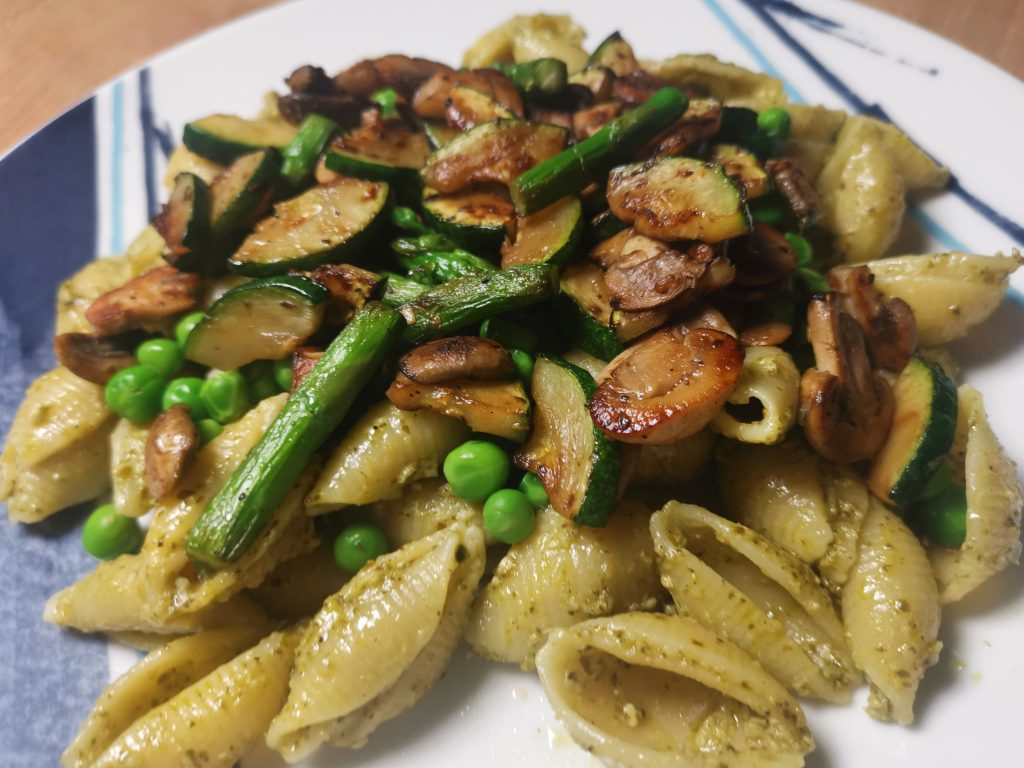 Pesto pasta (vegan version) topped with spring vegetables
