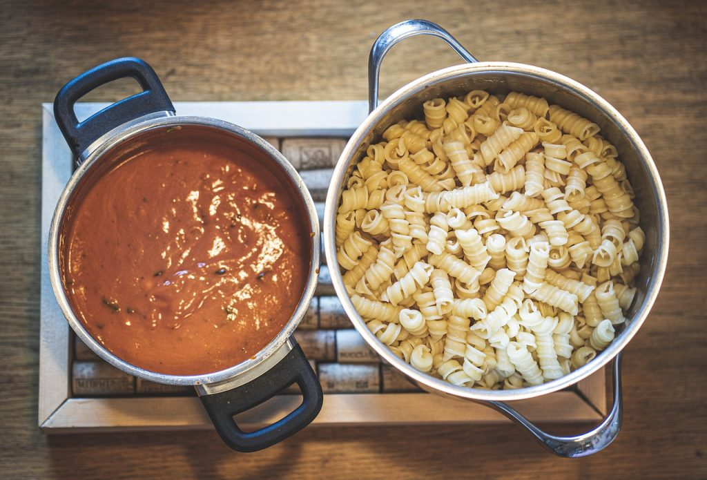 Pasta and sauce being cooked