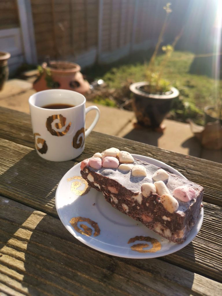 Rocky road bar with coffee on garden table