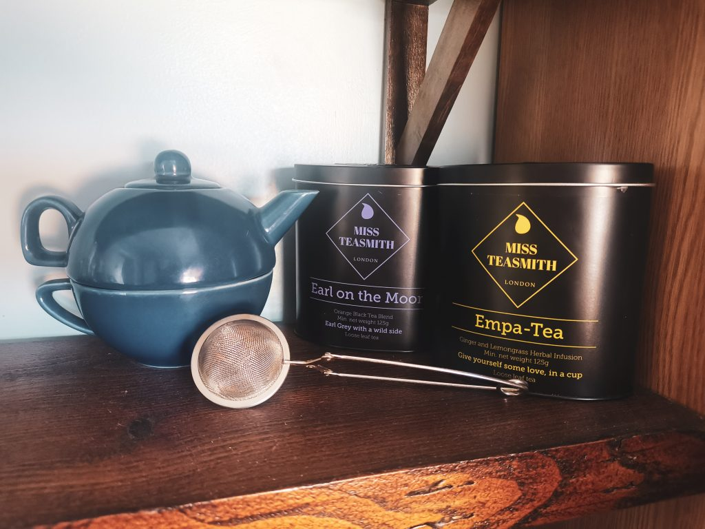 Two loose leaf tea blends from Miss TeaSmith with teapot and strainer