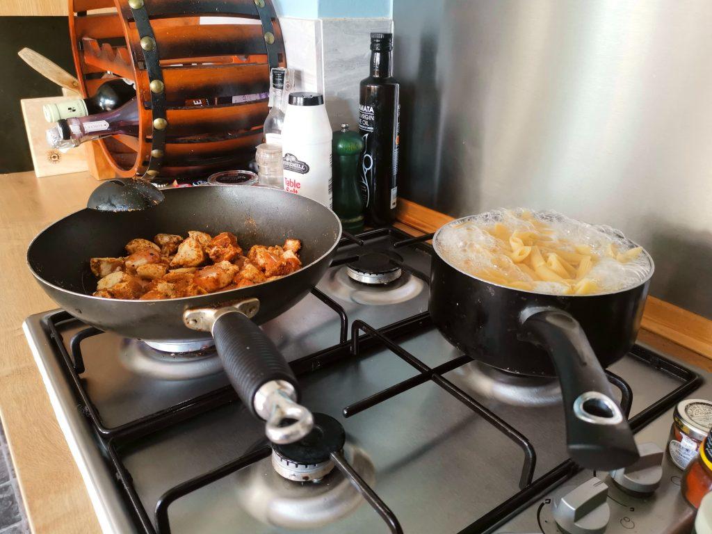 Cooking the chicken fajita pasta on the hob