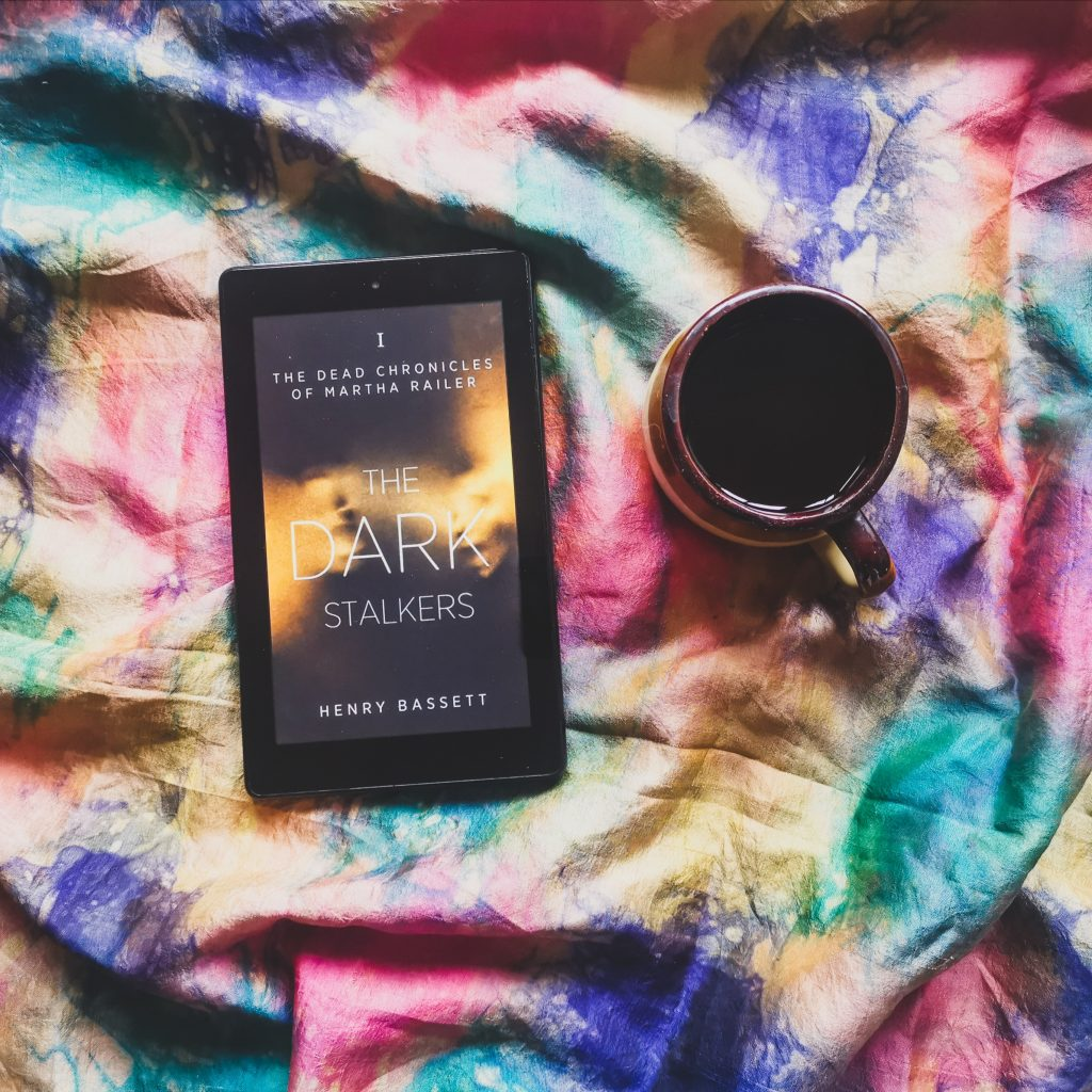 The Dark Stalkers on Kindle with black coffee