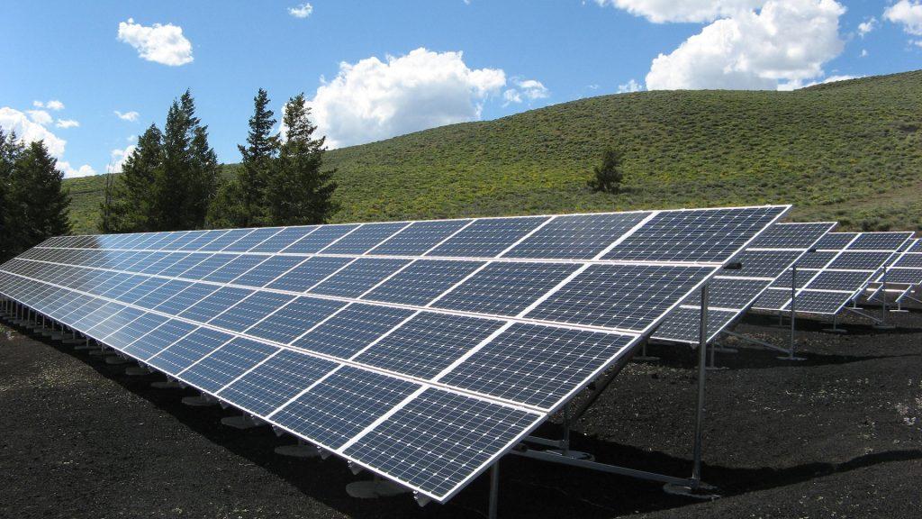 Rows of solar panels on a hillside