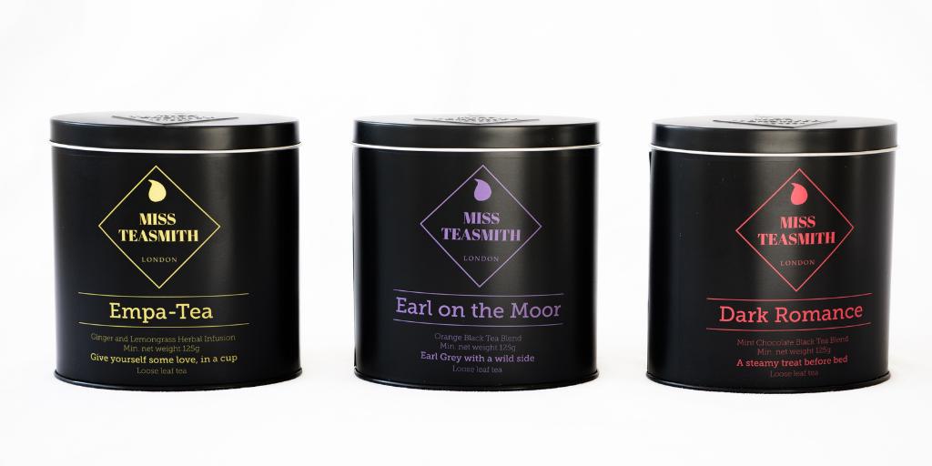 Three black tins of loose leaf tea blends from Miss TeaSmith - Empa-Tea, Earl on the Moor, and Dark Romance