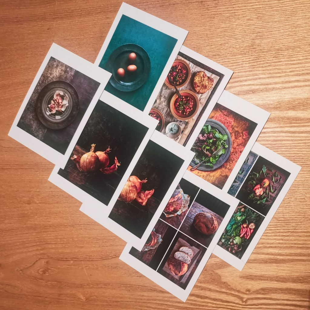 Eight postcards of food photography containing food photography tricks layered on top of each other on a wooden table