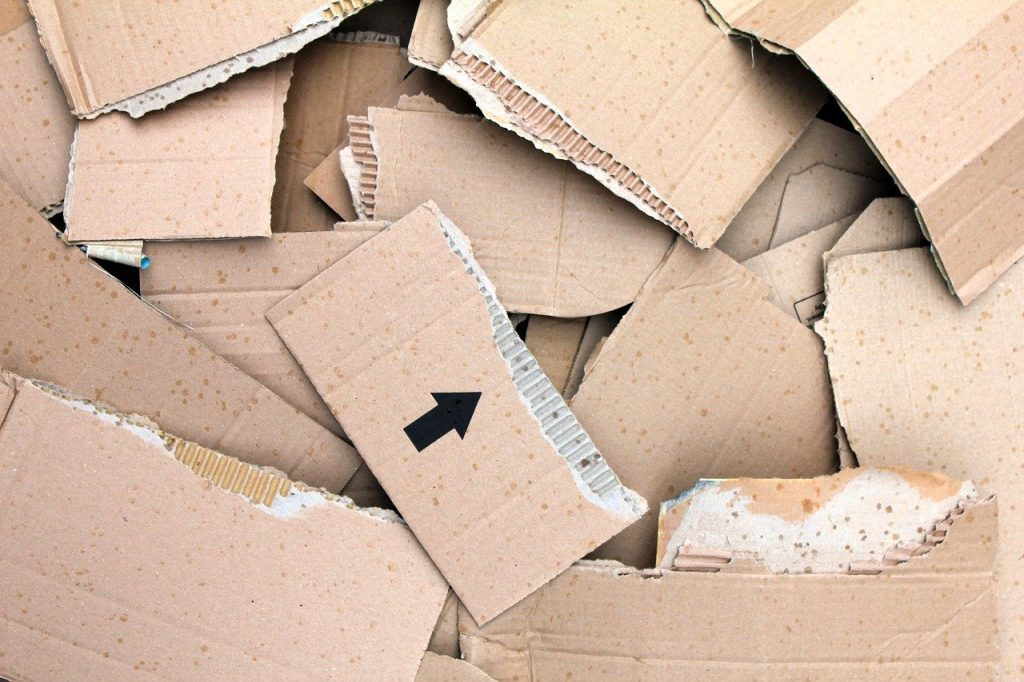 Layered pieces of ripped corrugated cardboard