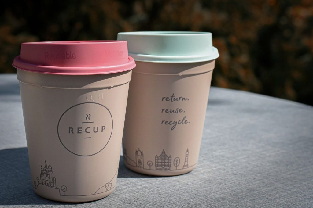 Two reusable coffee cups on desk